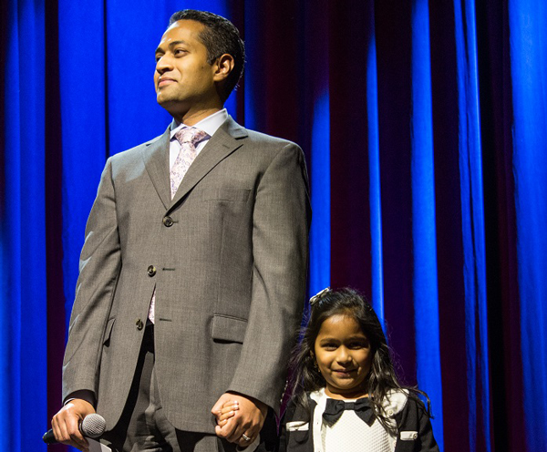 Dads for Daughter's member, Vijay Kotte, on stage with his daughter